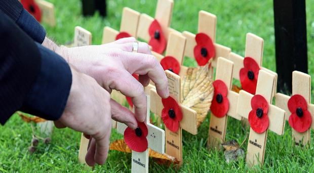 Remembrance Sunday parades are being affected by police budget cuts, Labour's Andy Burnham has said