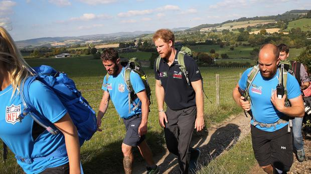 Prince Harry joins Walking with the Wounded's Walk of Britain team during their walk to Ludlow in Shropshire as they trek the length of the country on their own personal roads to recovery.