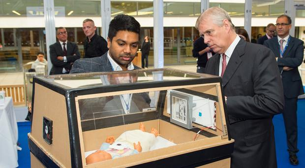 The Duke of York is shown a low-cost incubator at the
