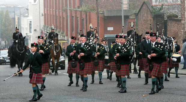 The PSNI 's pipe band at the funeral