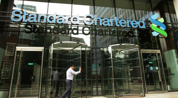 Standard Chartered bank has announced a third-quarter pre-tax loss of 90 million pounds