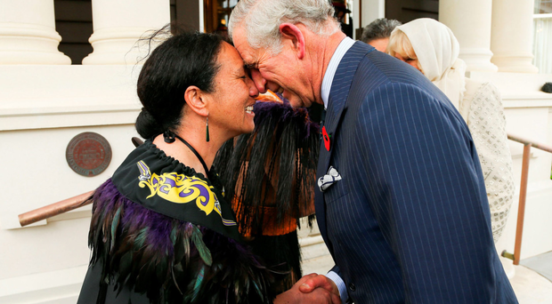 Prince Charles is greeted with a hongi during a welcome ceremony in Wellington, New Zealand, yesterday