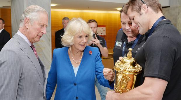 The Prince of Wales and Duchess of Cornwall congratulate New Zealand's All Blacks team after they won the Rugby World Cup