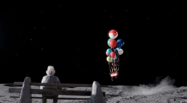 The ad features the story of a young girl named Lily striking up a connection with an elderly man living alone on the moon