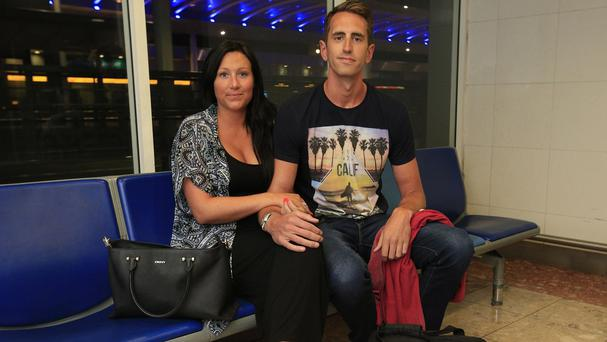 Emily Alfeo and Marc Standen at Gatwick Airport after returning on a flight from Sharm el-Sheikh