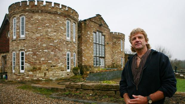 Robert Fidler outside the home he built without planning permission in Salfords near Redhill, Surrey
