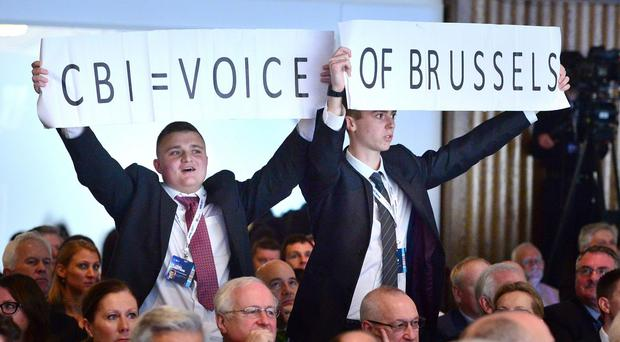 Protesters during David Cameron's speech at the annual conference of the CBI