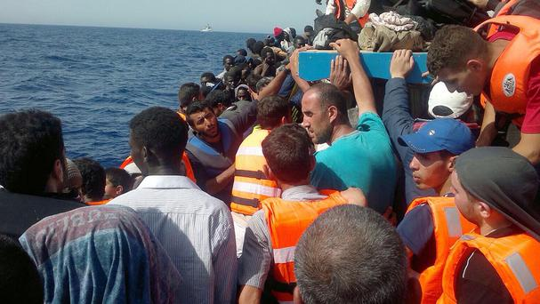 Migrants and refugees on a boat from Libya travelling to Italy (Migrant Voice UK/PA)