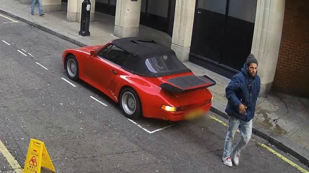 A CCTV image shows a man police would like to speak to following damage to a red Porsche in London (Metropolitan Police/PA)