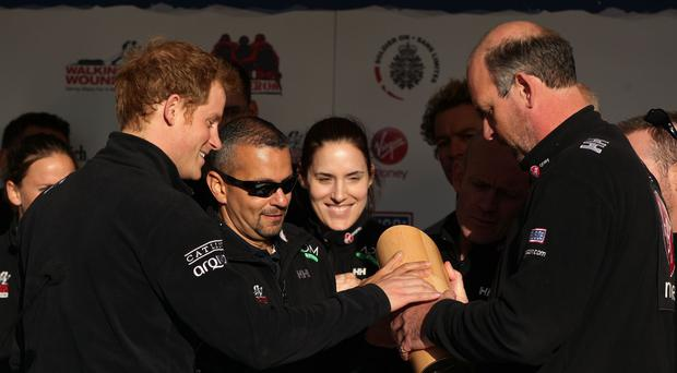 Prince Harry and Ed Parke, co-founder of Walking With The Wounded, holding the Endeavour Trophy
