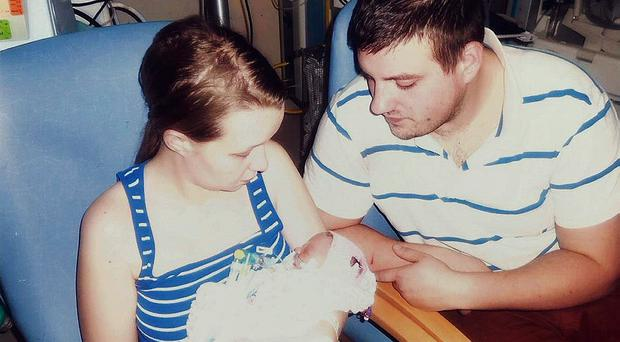 Clara Bassford and Mark Hubbard with their daughter Delilah who died at two days old, as an NHS trust admitted failings which led to her death (Family handout/PA)