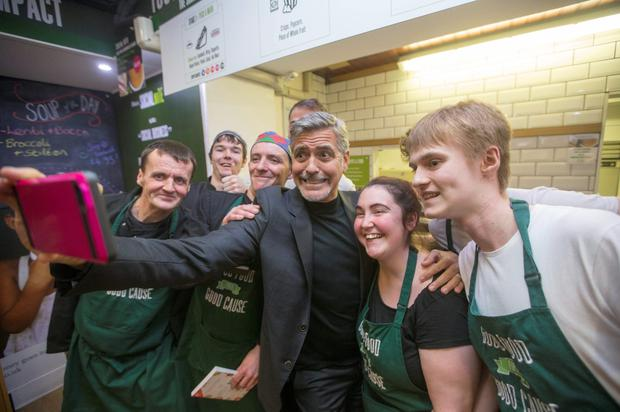 Hollywood star George Clooney caused a stir during a visit to Social Bite sandwich shop in Edinburgh yesterday