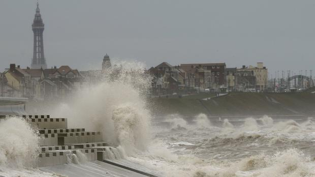 Waves crash against the sea wall in Blackpool as the Met Office issued a warning for severe weather in the north west