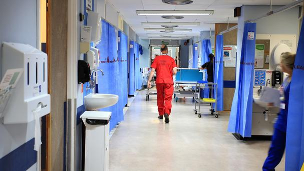 A report warns NHS trusts will end the financial year £2.2 billion in debt