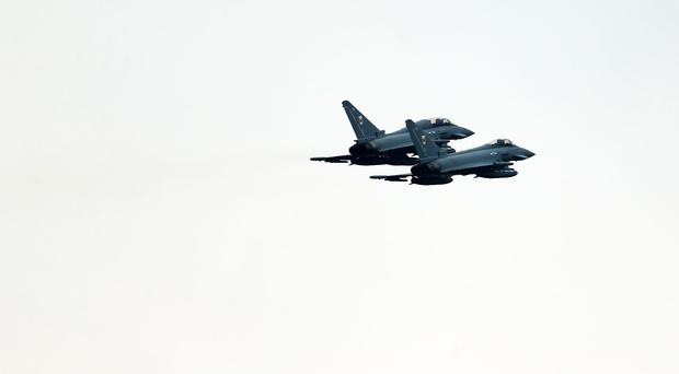 The Ministry of Defence said two Typhoon jets were scrambled from RAF Lossiemouth to intercept Russian aircraft