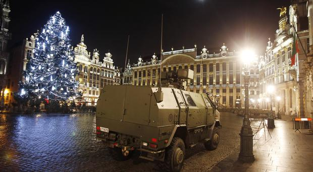 A police vehicle is parked at the Grand Place in central Brussels (AP)