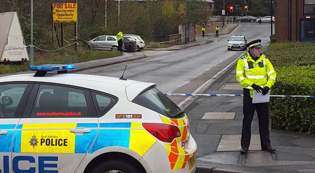 Police at Napier Street, Sheffield, after a body believed to be that of missing university student Caroline Everest was found in a river