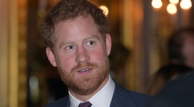 Prince Harry, at a reception for the Endeavour Fund, a project led by his and the Duke and Duchess of Cambridge's Royal Foundation, where he stepped up the drive to help wounded service personnel through sport and adventure, at St James's Palace, central London.