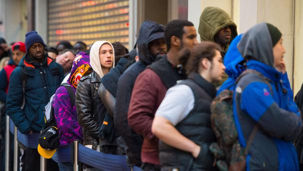 Shoppers queue outside a branch of Foot Locker on Oxford Street, London, as many retailers offer one day sales for Black Friday