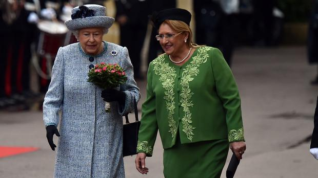 The Queen is greeted by Maltese president Marie Louise Coleiro as she arrives at San Anton Palace in Attard