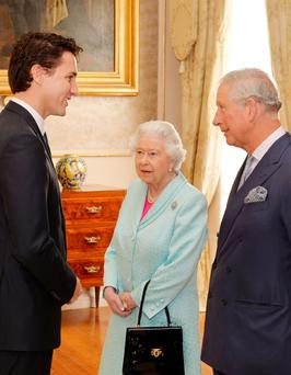 Canadian Prime Minister Justin Trudeau talks to the Queen and Prince Charles during a Heads of Government reception at the San Anton Palace in Attard, Malta, yesterday