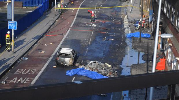 The scene after a helicopter crashed into a construction crane on top of St George's Wharf tower building in Vauxhall, south London