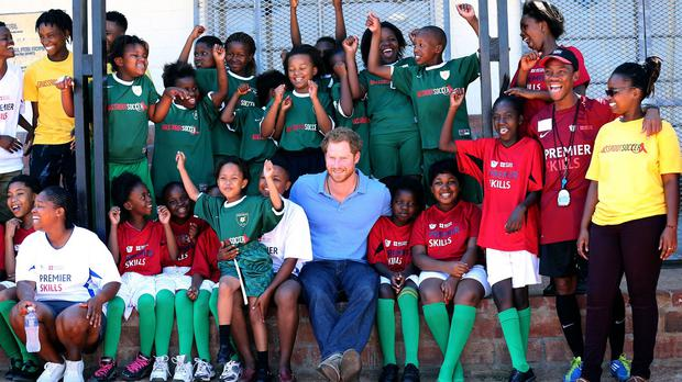 Prince Harry plays with children from local communities at the Football for Hope Centre in the Khayelitsha Township on the first day of his visit to South Africa