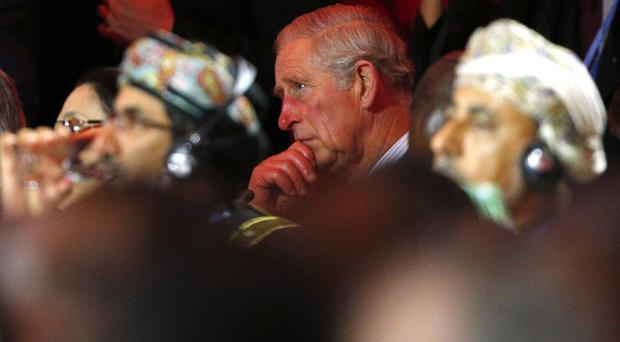 Charles will be joined at an event on forests at the talks by politicians and business leaders (AP)