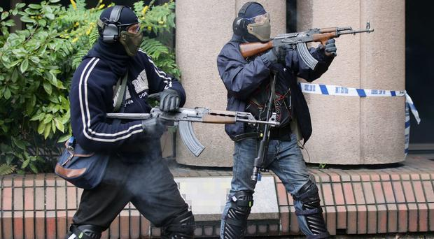 Firearms instructors play the part of terrorists in a training programme for armed officers when responding to a terrorist firearms attack