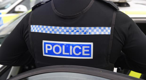 Police have charged a man after a laptop was stolen during a child's funeral