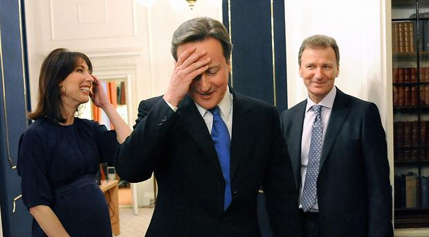 David Cameron pictured arriving in Downing Street's Cabinet Room after his appointment as Prime Minister in 2010