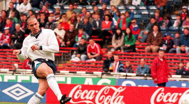 Stan Collymore, pictured playing for England, has joined the SNP