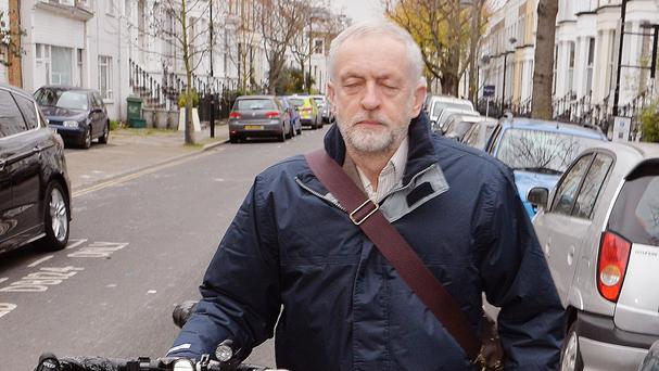 Labour leader Jeremy Corbyn leaves his north London home as RAF Tornado jets carried out the first British bombing runs over Syria