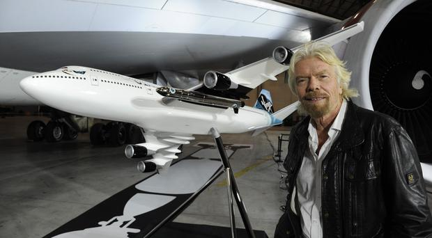 Sir Richard Branson with the 747-400 that will be turned into a launchpad for the Virgin Galactic spaceship (Virgin Galactic/PA)