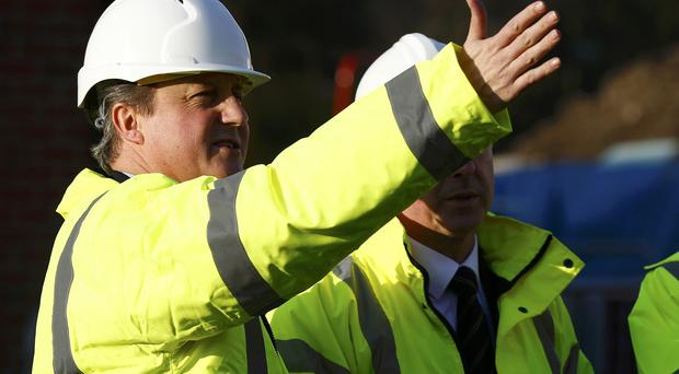 Prime Minister David Cameron speaking to builders during a visit to the Orbit Homes development in Burton Upon Trent