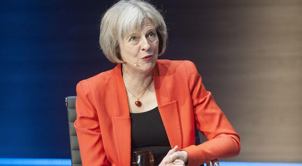Home Secretary Theresa May abolished national targets for police in 2010
