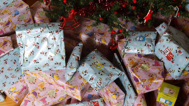 Thieves ripped a hole in wall panels to get in and stole the wrapped presents