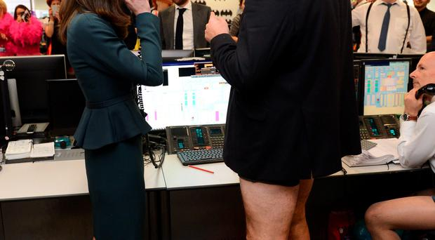 The Duchess of Cambridge with hotpants-clad trader Nigel Hallagan, and 'Wicked Witch' Amanda Hartnell. Below: Kate with her longer locks a month ago