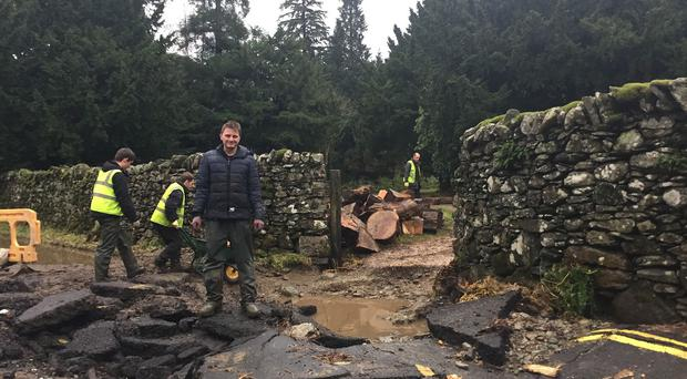 Jon Holdsworth of Patterdale Hall Estate inspects flood damage outside the estate, near the village of Glenridding in Cumbria
