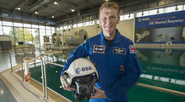 Major Peake will head into space with two crew companions, Russian commander Yuri Malenchenko and American Nasa astronaut Tim Kopra