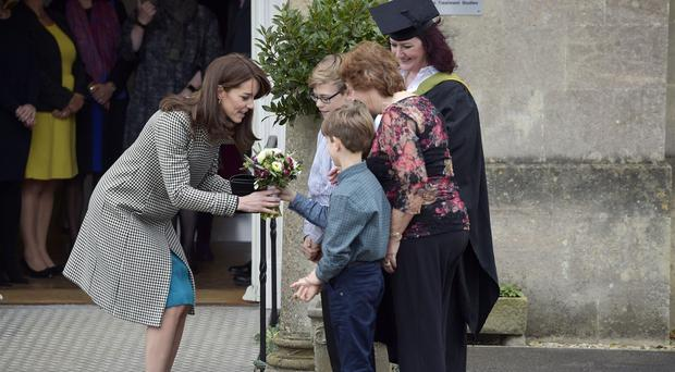 The Duchess of Cambridge receives a bouquet as she leaves Action on Addiction's Centre for Addiction Treatment Studies in Warminster, Wiltshire