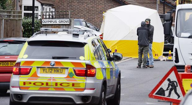Officers at the scene in Bracknell Close, north London, after a man died after being shot during an