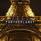 "The slogan ""For the planet"" is projected on the Eiffel Tower as part of the COP21, the United Nations Climate Change Conference in Paris (AP)"