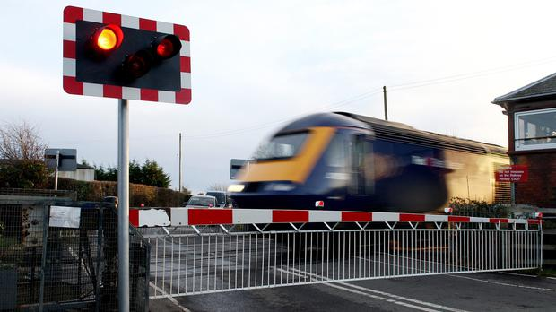 Network Rail is sending advice on how to cross the railway to Britain's largest road fleets