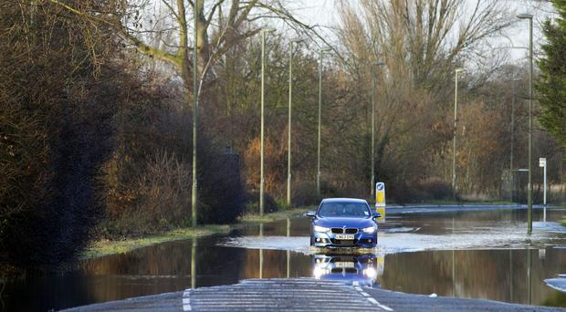 Investment in flood defences must be protected despite Government spending cuts, MPs have warned