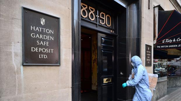 A police forensics officer entering the Hatton Garden Safe Deposit company