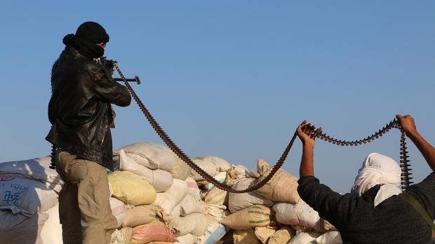 Tribal fighters take position on a street during fighting with Shiite rebels known as Houthis on the outskirts of Taiz, Yemen (AP)
