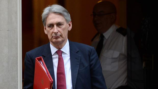 Foreign Secretary Philip Hammond has welcomed unanimous approval of a United Nations resolution endorsing a peace process for Syria