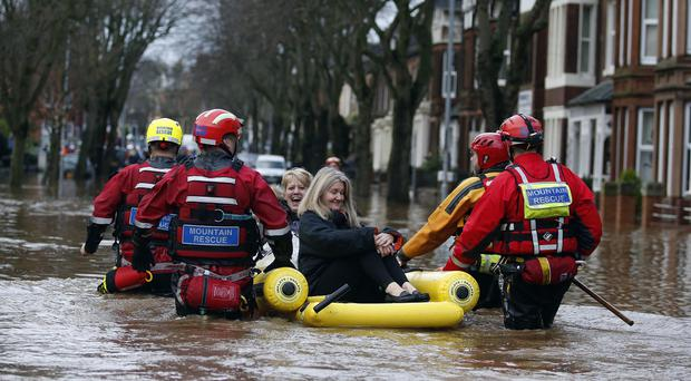 Charles will visit Warwick Road in Carlisle, which flooded as heavy rain from Storm Desmond tore through Britain