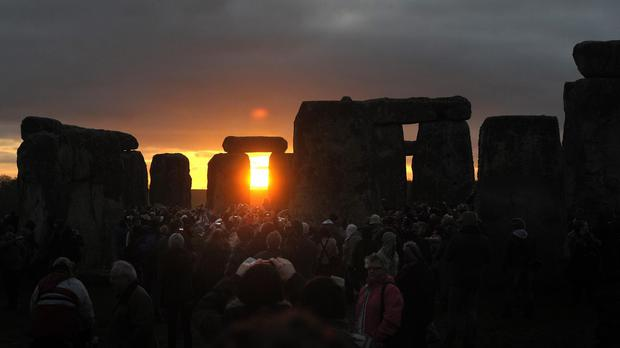 Thousands travel to watch the sunrise at the Winter Solstice celebration at Stonehenge in Wiltshire each year